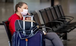 A masked traveller at Schiphol airport