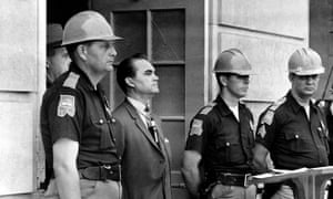 Alabama governor George Wallace blocked the entrance to the University of Alabama to prevent black students from enrolling, 1963.