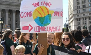 People gather during the global climate strike march at Foley Square in New York