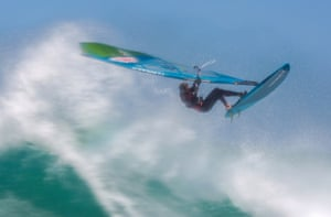 Cape Town, South Africa Professional windsurfer Florian Jung from Germany wavesails during a training session. Many top windsurfers train in Cape Town during the summer due to its strong winds and big waves.