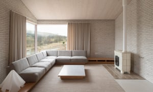 The living room area of Tŷ Bywyd (Life House), decorated in neutral tones, part of the Living Architecture project.