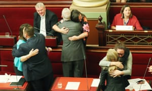 MPs in Victoria, Australia, embrace after the passing of the Voluntary Assisted Dying Bill in 2017.