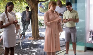 A scene from Black Mirror, with Bryce Dallas Howard, and four other characters, all on their phones