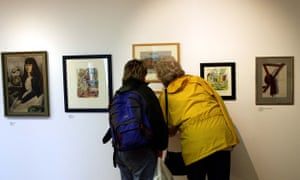 Women looking at pictures in the Garman Ryan collection at the New Art Gallery Walsall