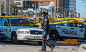 The scene in northern Toronto after a van drove along  a sidewalk striking pedestrians.
