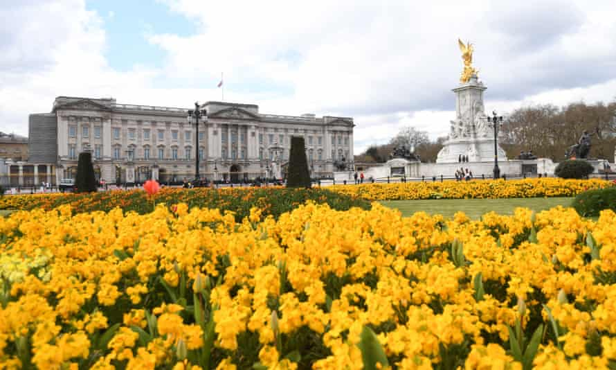 People stand outside Buckingham Palace after the death of Prince Philip.