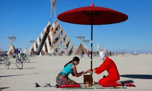 A tea ceremony at Burning Man in 2011. Participation, exploration and gift giving are part of the festival's ethos.