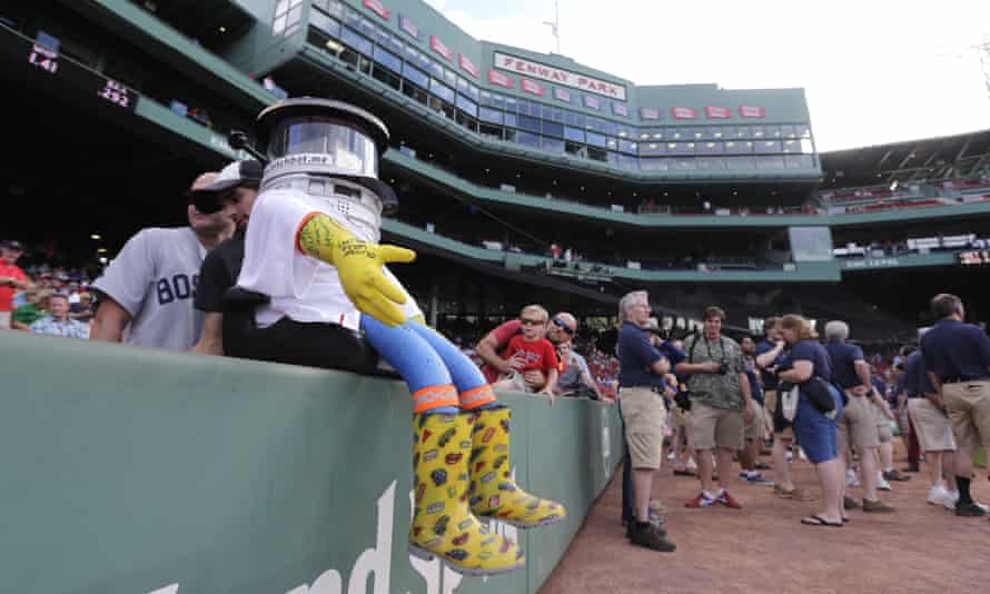 Hitchbot takes in pre-game activity in Boston's Fenway Park.
