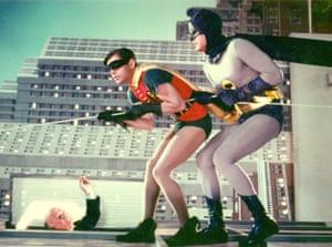 Adam West as the Caped Crusader and Burt Ward as Robin - The Boy Wonder perform a death defying stunt
