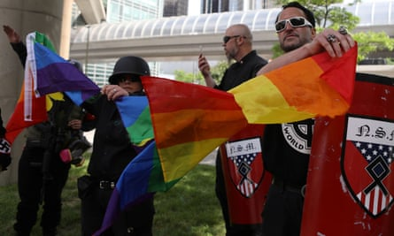Members of the National Socialist Movement tear apart a Pride flag at in Detroit, Michigan, on 8 June.