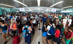 Travellers queue at the security checkpoints at Barcelona-El Prat airport, Spain.