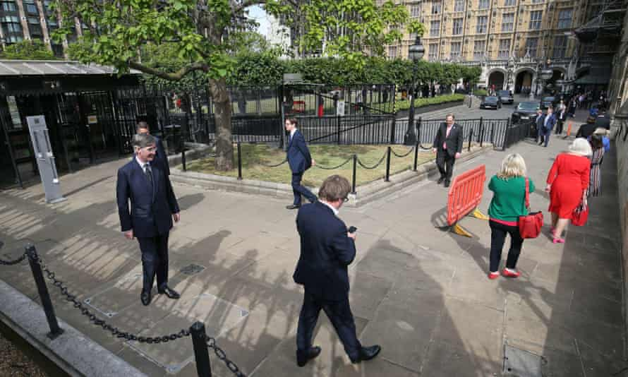 MPs including the leader of the House of Commons, Jacob Rees-Mogg, queue outside the Palace of Westminster on Tuesday.