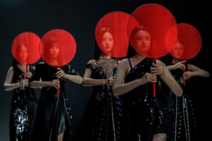 Beijing, China, Models present creations from the SGM ART MOUSE JI during China Fashion Week