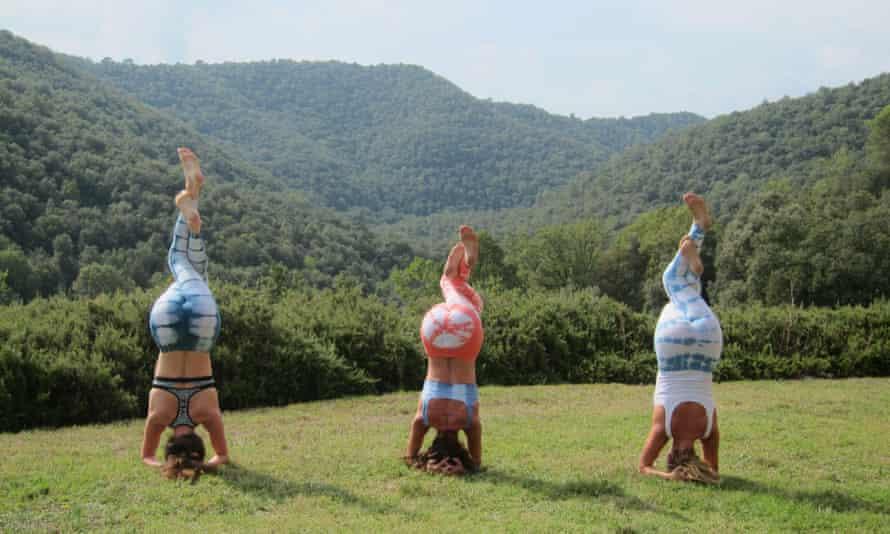 Three women practising a yoga position at Chaya Yoga Retreats Ibiza