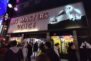 HMV store at night with Nipper the dog and gramophone on signage.
