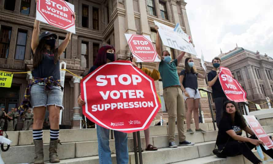 Voting rights activists gather during a protest against Texas legislators who are advancing a slew of new voting restrictions in Austin, Texas, on 8 May 2021.