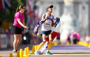 Yohann Diniz of France celebrates as he crosses the finish line to win the gold medal in the men's 50km walk at the World Athletics Championships in London