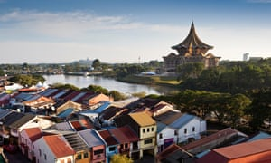 view over Chinatown and the Sarawak river to the State Assembly Building.