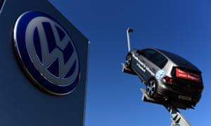 A VW car and logo at the entrance to a VW branch in Duesseldorf