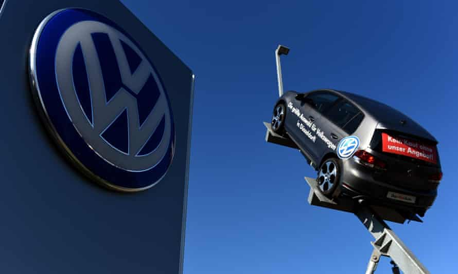 A model and logo of German car maker Volkswagen (VW) at the entrance to a branch in Düsseldorf, western Germany.