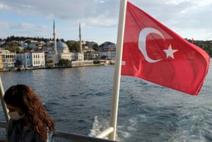 A woman travels on a ferry over the Bosphorus in Istanbul.