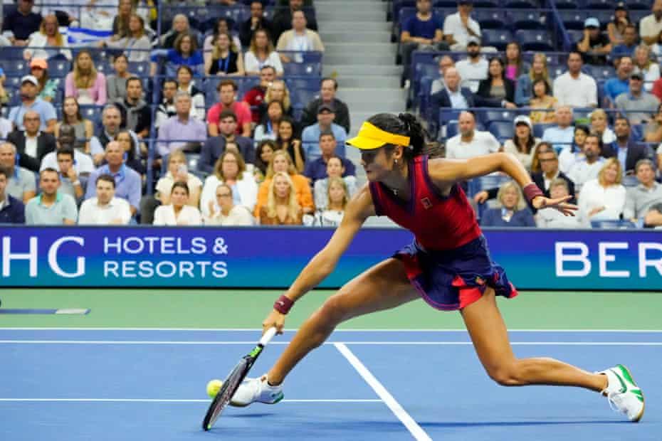 Emma Raducanu plays a low backhand against Maria Sakkari in their US Open semi-final