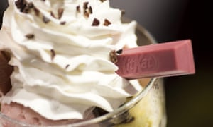 a raspberry flavoured KitKat finger adorns a whipped mousse dessert
