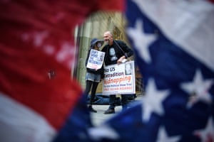London, UKSupporters of the Wikileaks founder Julian Assange are seen through a torn US flag as they gather outside the Old Bailey. Julian Assange is fighting an extradition request by the United States on charges of hacking and espionage, avoided for years by seeking refuge in London's Ecuadorian embassy in 2012