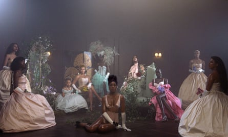 Beyoncé and her daughter Blue Ivy Carter, seated background left, and Kelly Rowland, center, in Brown Skin Girl from visual album Black Is King.