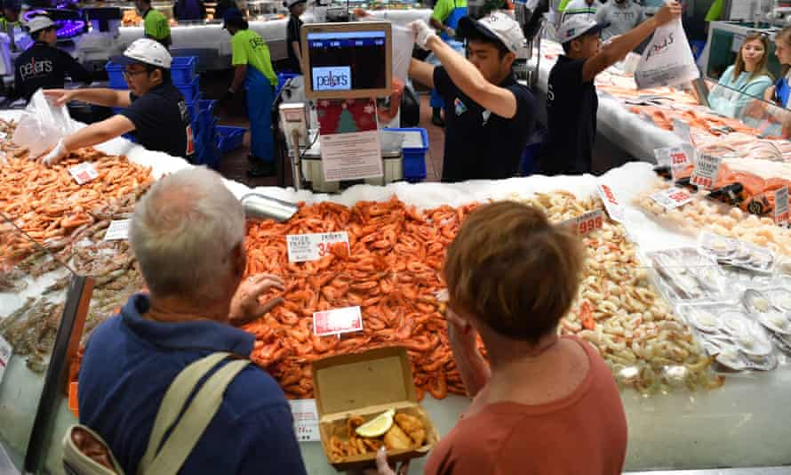 People buying seafood at Sydney Fish Market