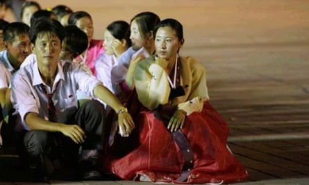 North Korean dancers rest after performance during celebrations to mark anniversary of founding of North Korean Youth League in Pyongyang.
