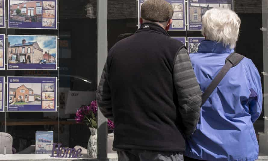 A couple looking at an estate agent's window on Tuesday.