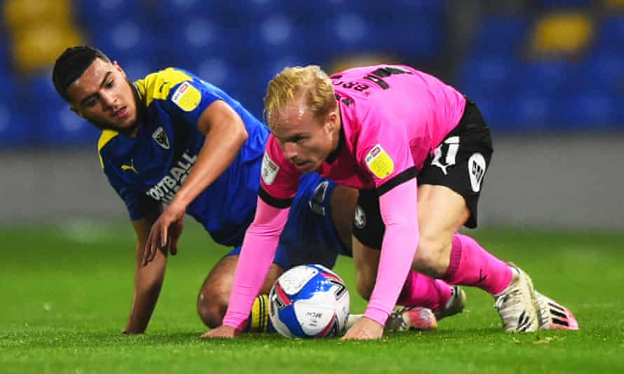 Peterborough, whose midfielder Ryan Broom (right) is in action here against AFC Wimbledon, are among the teams who want the PFA to fund Covid tests.