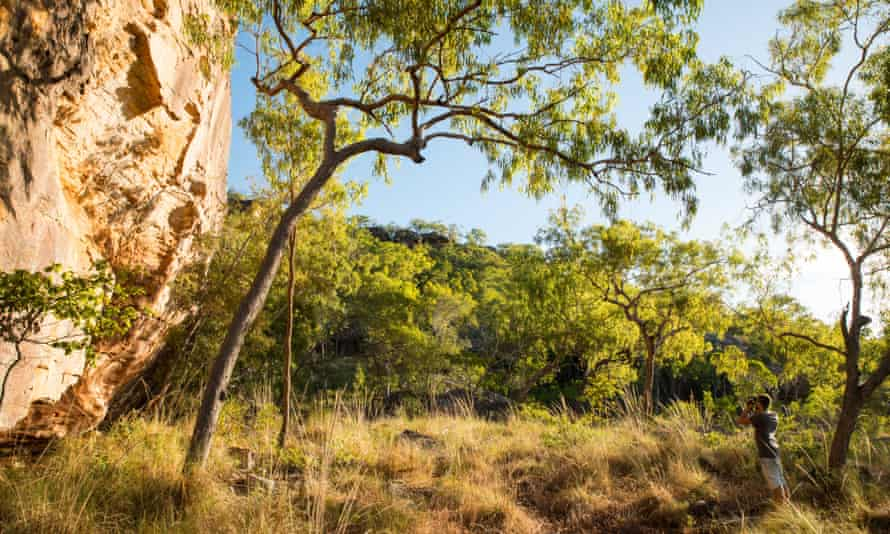 A visitor looks around the Laura sandstone outcrops in North Queensland.