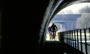 Cyclists on a canal towpath in Birmingham