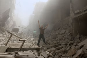 A man gestures amid the rubble of destroyed buildings after an airstrike on the rebel-held neighbourhood of al-Kalasa in Aleppo.