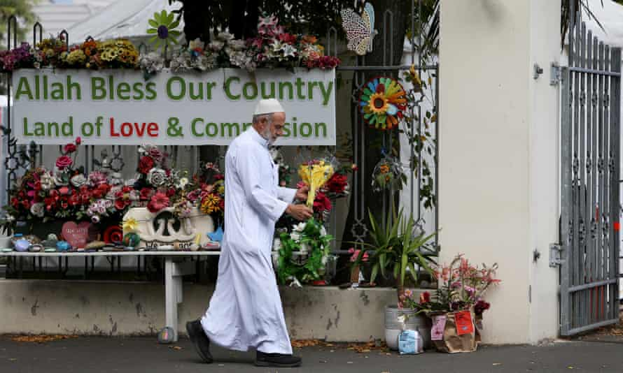 Flowers at the entrance to Al-Noor mosque on the anniversary of the Christchurch shooting. The Australian man who pleaded guilty to the attack will represent himself at next month's sentencing.