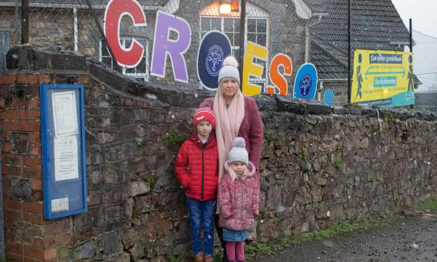 Cara Young, with her son Dewi and daughter Milly, outside the Mynyddygarreg school in Carmarthenshire