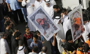 Saudis carry a poster demanding freedom for Nimr during a funeral procession in May last year.