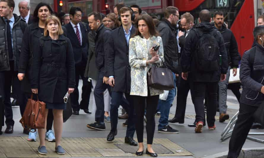 Office workers commuting to work during the morning rush hour in London.