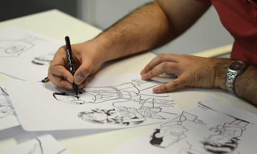 Guillermo Martínez-Vela sketches a cartoon for El Jueves