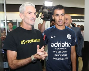 Hakeem al-Araibi (right) with Craig Foster, the former Socceroo who spearheaded the campaign to free him, at Melbourne airport.