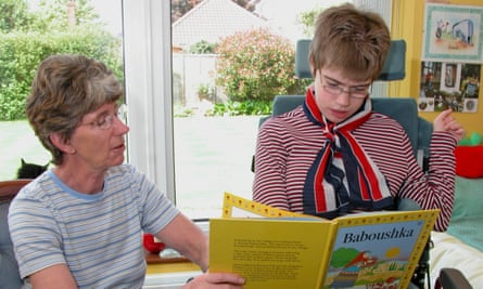 mother and her 18yr old daughter  looking at book