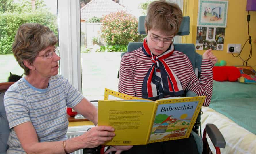 mother and teenage daughter reading