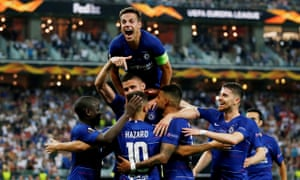 Chelsea's Eden Hazard is mobbed by his teammates after scoring their third goal.