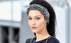Bella Hadid wears a headband as she walks the runway during the Chanel show as part of the Paris Fashion Week in 2017.