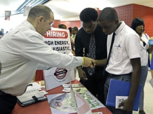 In this photo taken Wednesday, June 10, 2015, Mario Polo, of Boston Market, left, talks to job seekers Herby Joseph, right, and Kingsly Jose, center, at a job fair in Sunrise, Fla. The Labor Department issues its May report on job openings and labor turnover on Tuesday, July 7, 2015. (AP Photo/Alan Diaz)