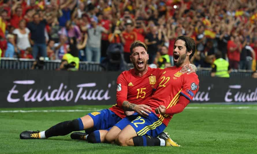 Isco celebrates with Sergio Ramos after scoring Spain's opening goal in the 3-0 win against Italy in September