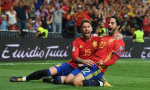 Defender Sergio Ramos, left, helps Isco celebrate the first of the midfielder's two goals in Spain's 3-0 win over Italy in World Cup qualifying.
