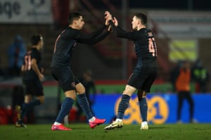 Phil Foden of Manchester City celebrates with team mate Joao Cancelo.